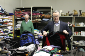 Jubilee's Mercy Store provides donated clothing, blankets and food.  Melissa Rosado sorted books while Wally Jr. and Wally Sr. folded men's clothing and blankets.