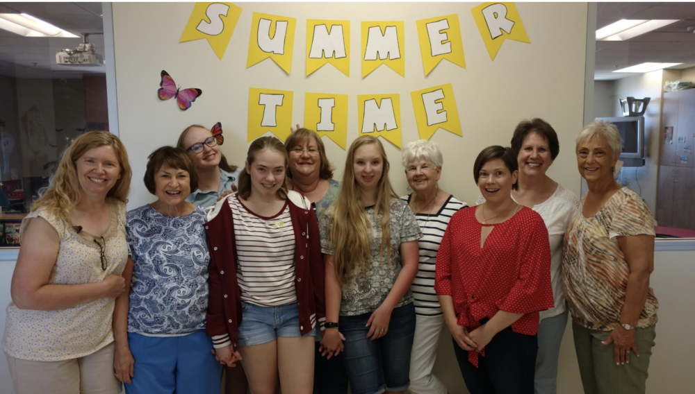MGF Volunteer Team leader, Juanita Peterson, [far right] led the wonderful volunteers, Marie, Gabby & Jessica Brown, Wendy Hines, Abby & Susie, Bert Gabel and Bobbie Stegall helping the residents celebrate their #1 cheerleader in life.
