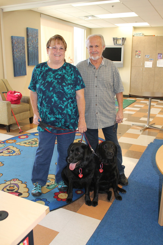 Al & Lyndy with 2 dogs.jpg