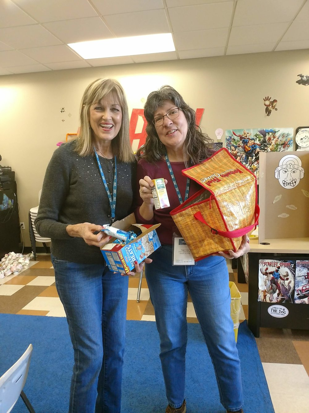 Jolyn Avants and Peggy Casey passing treats for the kids