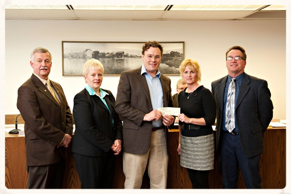 Jonas Zahn presenting a check to the City of Jefferson for an urban tree planting initiative.