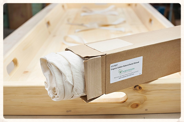 An organic natural burial shroud with a wooden natural burial trundle could be the future in Western funeral service.