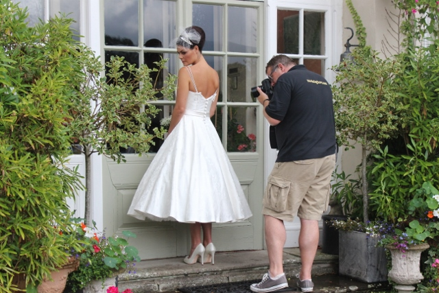 Photographer Mark Cleghorn taking a close up of the back of our gorgeous silk damask Hero gown.