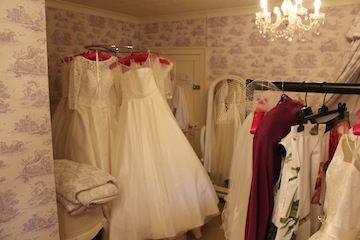 Here are some of the dresses ready for the shoot (after 6 hours of ironing!) This room is actually enormous but we managed to entirely fill it!