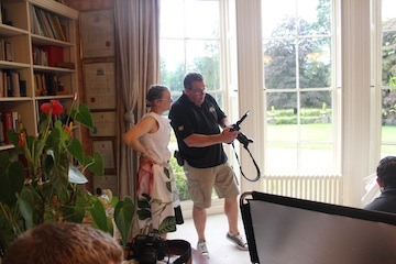 Photographer Mark Cleghorn and designer Angela Pitcher Dowdell checking an image on the camera.