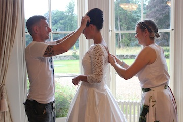 Stylist Carl and designer Angela getting our beautiful model Lowri ready for the next shot.
