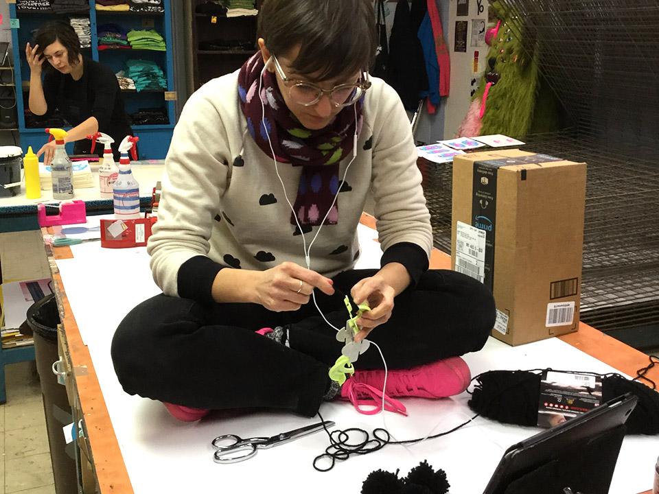 Making the pom poms with yarn and a pom pom maker