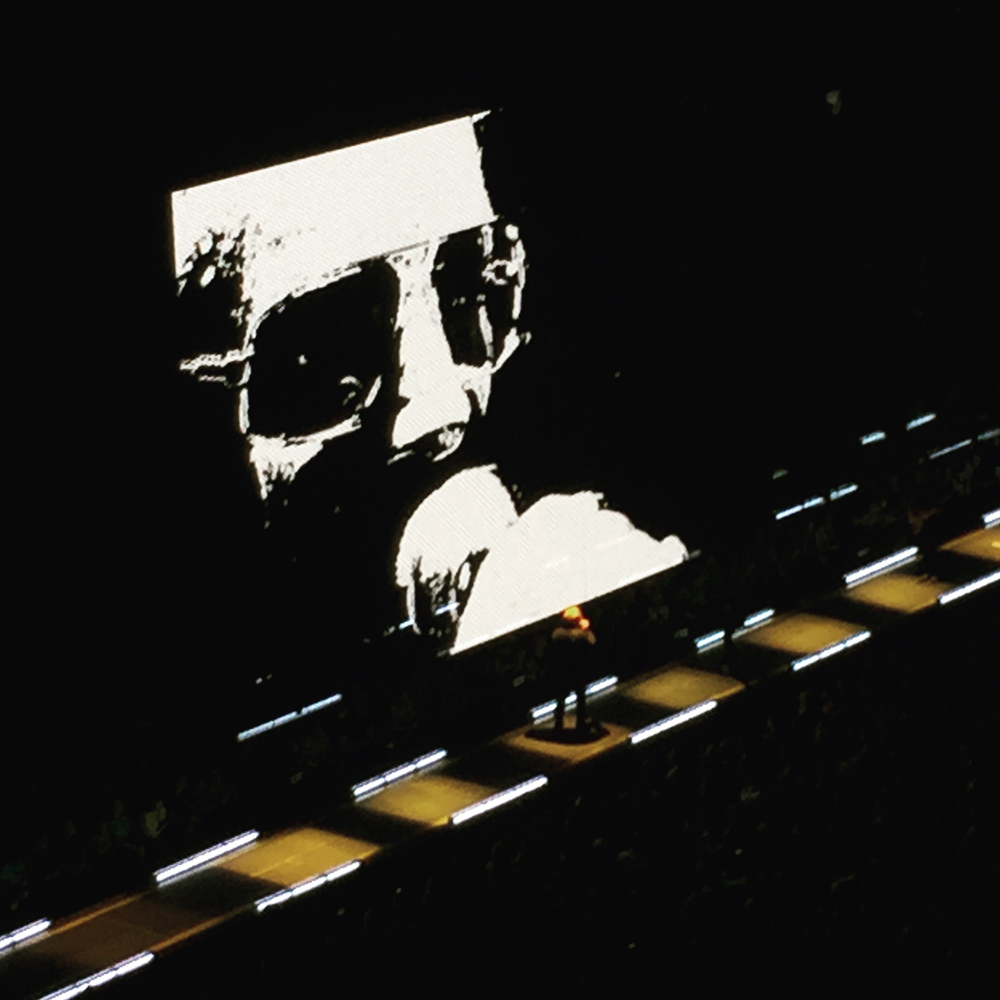 Complete with sunglasses, Bono takes center stage at the Pepsi Center. (Photo Credit: Farnaz Alimehri)