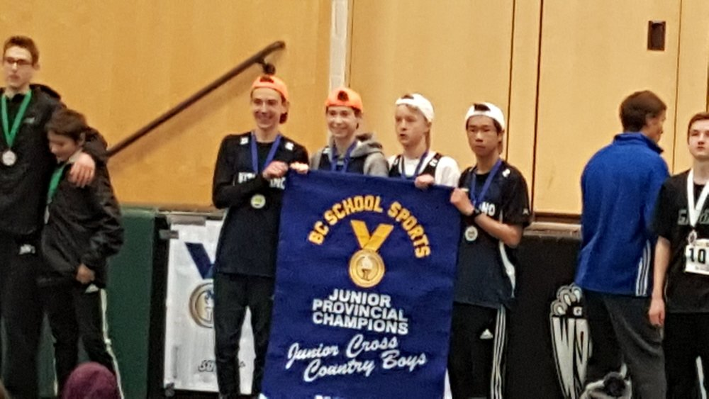 Thunderbird Athletes Riordan Miya (far right) and teammate Christian Peterson (second in from the right) of Kitsilano Secondary School placed 9th and 26th respectfully to help earn an overall team title for the Junior Boys BC XC Championships.