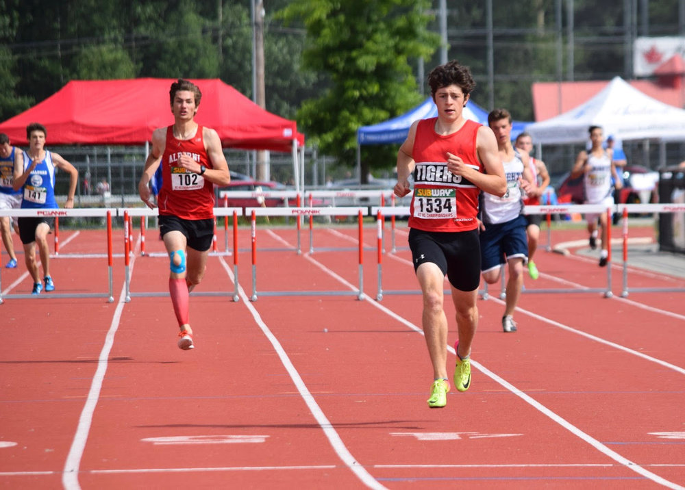 Paul Fisher en route to 400mH Victory at BC High School Championships.
