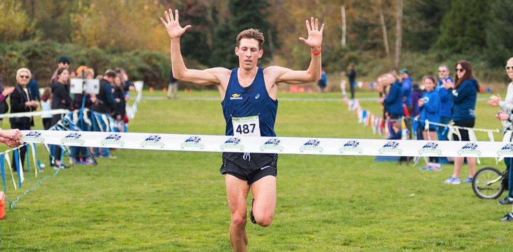Luc Bruchet wins the Senior Men's 8km race at the 2018 Provincial Cross Country Championships in Clearbrook Park, Abotsford.