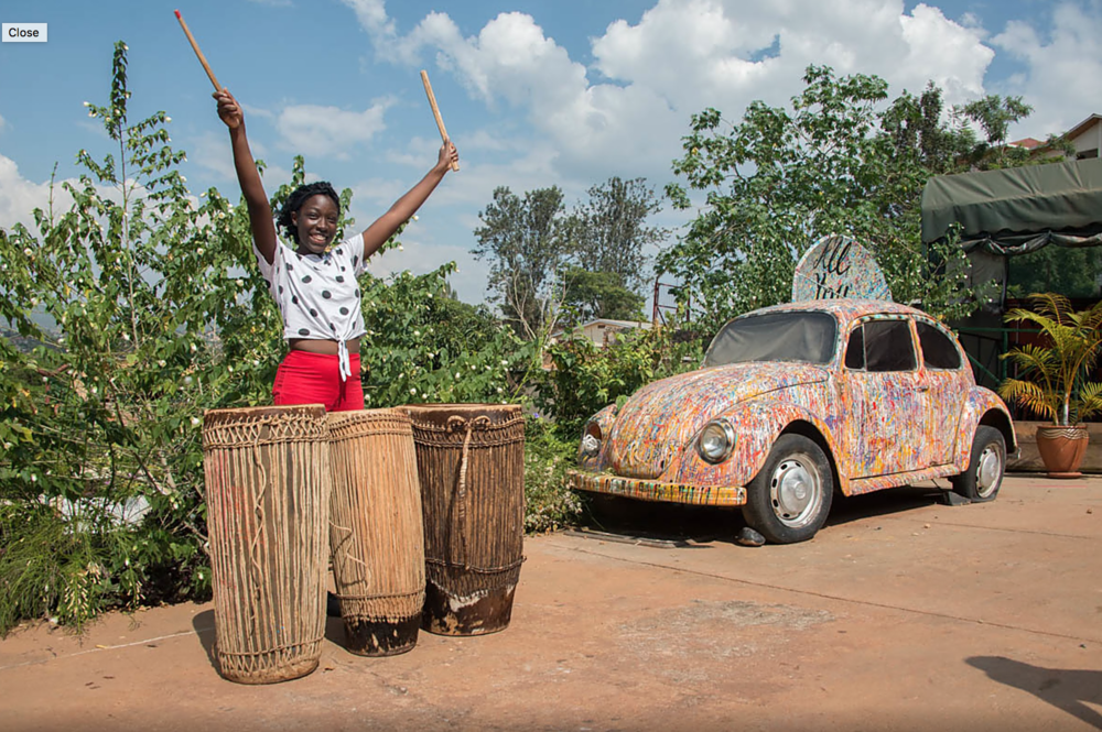 Crystal Holmes-Smith accompanies a traditional Rwandan dance lesson. Photo: Bruce Fox.