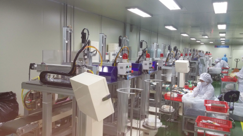 "Photo of ""Automatic Sheet Mask Folding Machine"" from GENIC CO., LTD. MaskerAide manufacturing facility"