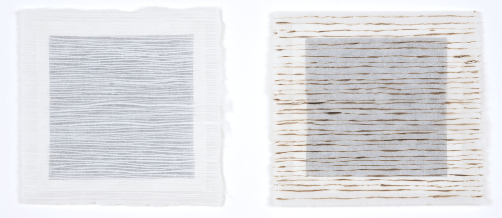 """Plus/Minus"" 2015 white ink and burn marks on rice paper suspended over a black background. Framed, 10""h x 20""w."