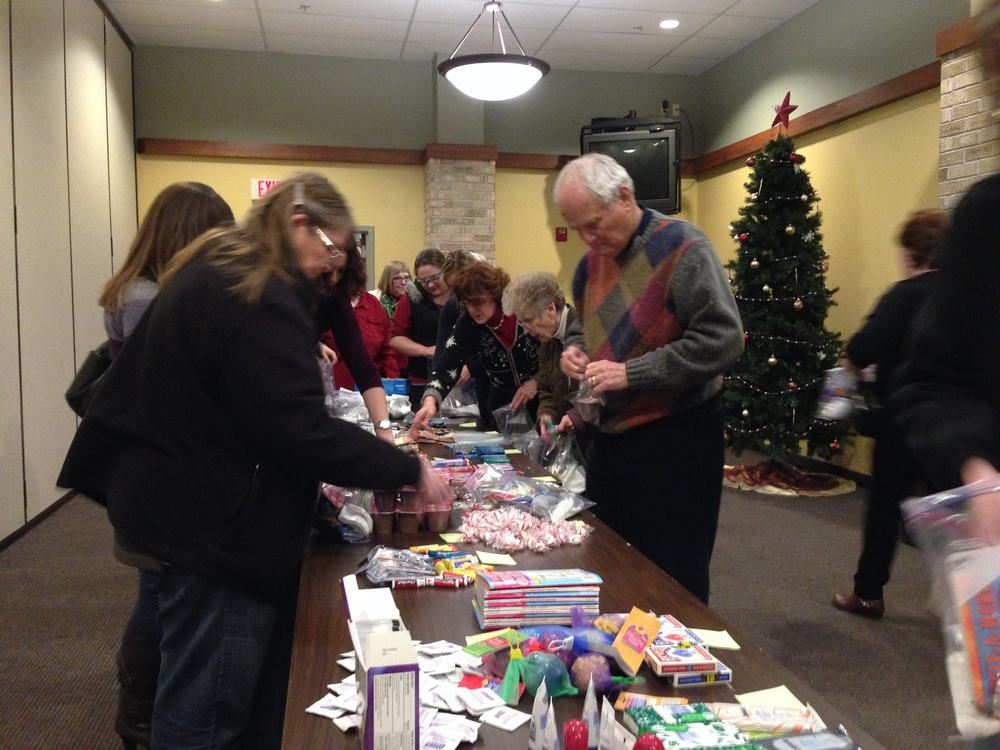Stuffing care bags for Troops