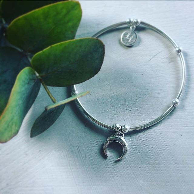 Symbolising new beginnings as well as fulfilling hopes & dreams; The Edna Crescent Moon is the perfect charm for the beginning of the new and bring you positive vibes 💜 #llloves #lllovesstory #lllovesuk #crescentmoon #crescent #newbeginnings #hopes #wishes #symboliccharms #sterlingsilver #handmadeintheuk #britishdesigner #uniquedesigns #letsdothis #newyear #positivemindset