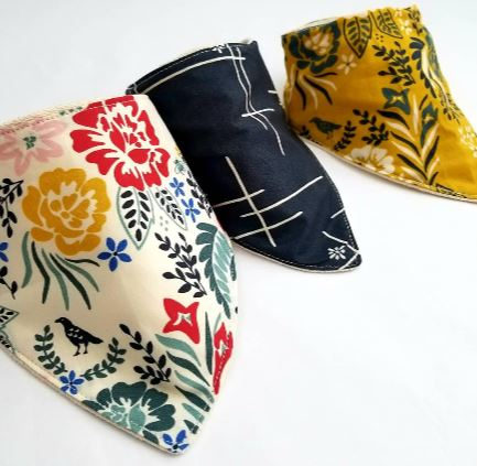 From left to right: Merry Floral Multi, Merry Hatch Dusk and Merry Floral Marigold Bandana / Drool Organic Cotton Bibs