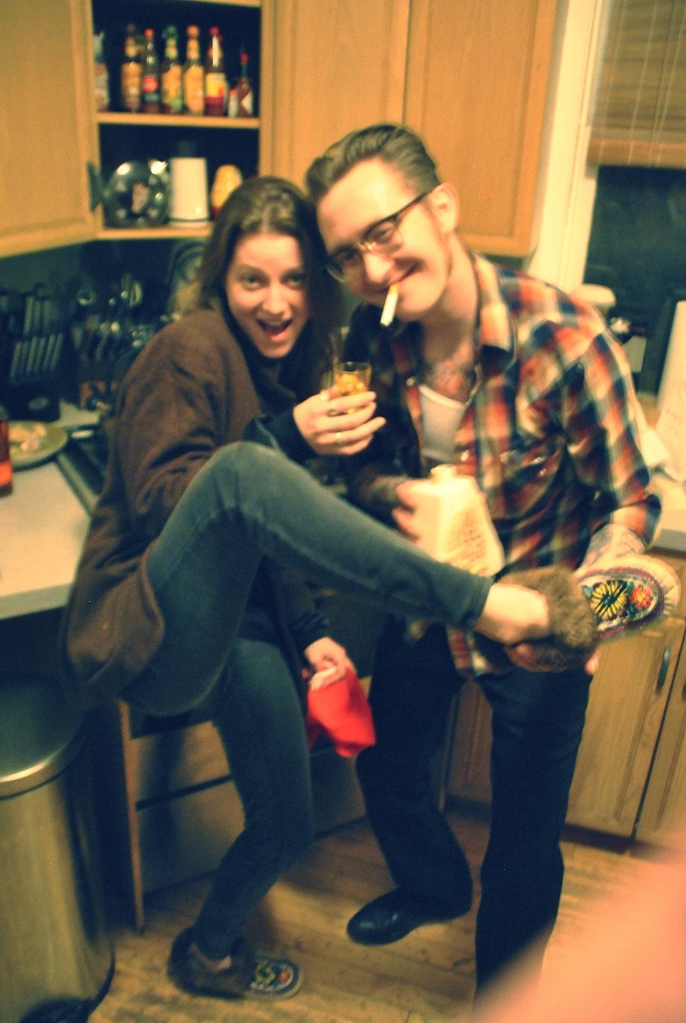 sharing fancy booze + moccasins = HOSPITALITY!