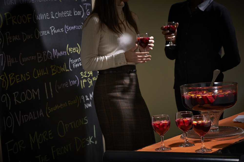 guests enjoy a sangria happy hour, and i love the chalkboaard wall with restaurant suggestions (photo courtesy the quincy)