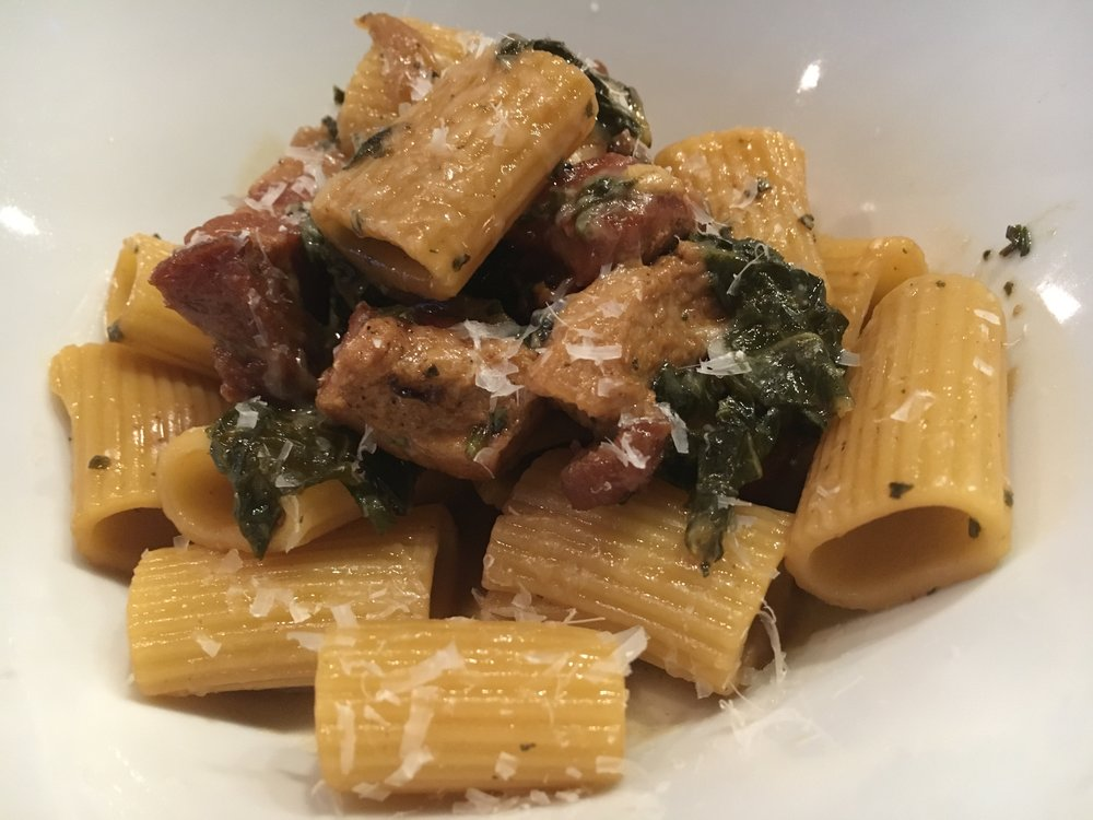 Pasta with pork belly ragu and kale