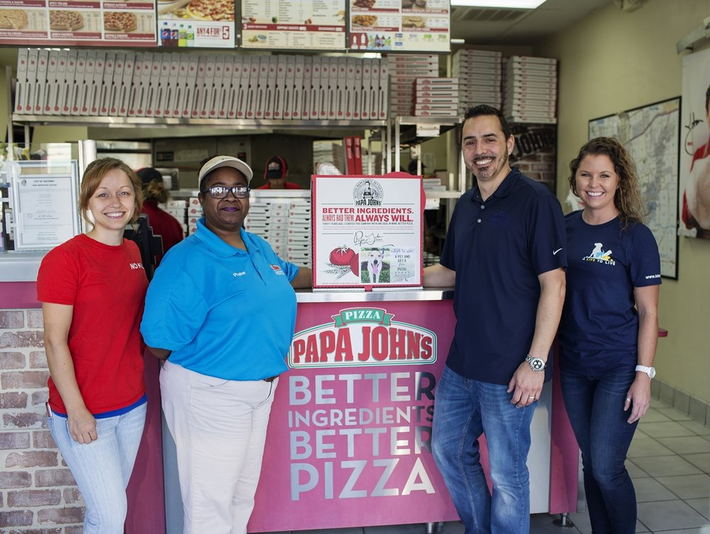 Promoting the collaboration between A Life to Live and Papa John's are (from left) Magan Gonzales, A Life to Live co-founder and program director; Phebe Hayes, Papa John's Baytown store manager; Adam Garza, director of marketing for Papa John's Houston; and Preslie Cox, A Life to Live marketing coordinator and box-top flyer designer.
