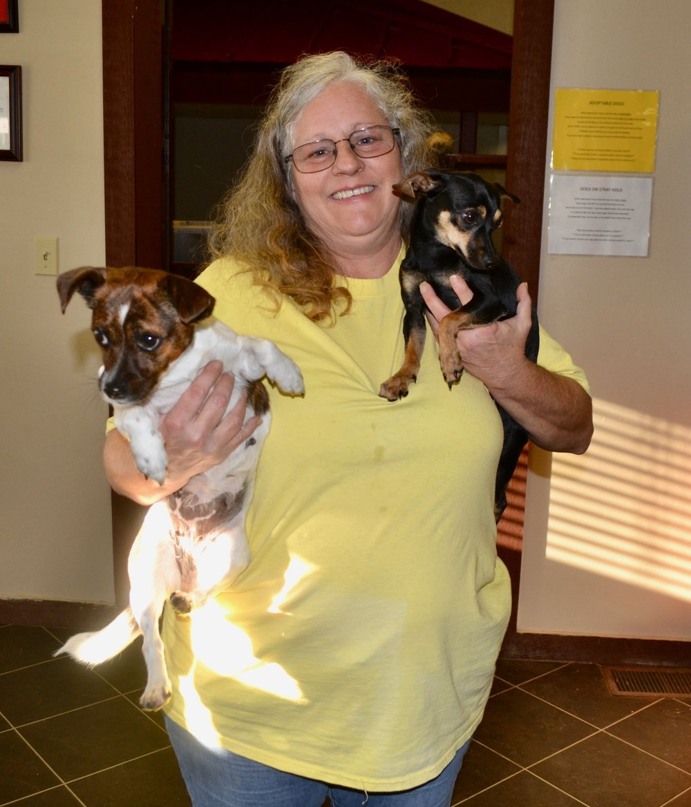 Deanna Domingue, another foster parent with newly enrolled pups Jimi (on right) and Janis (on left).