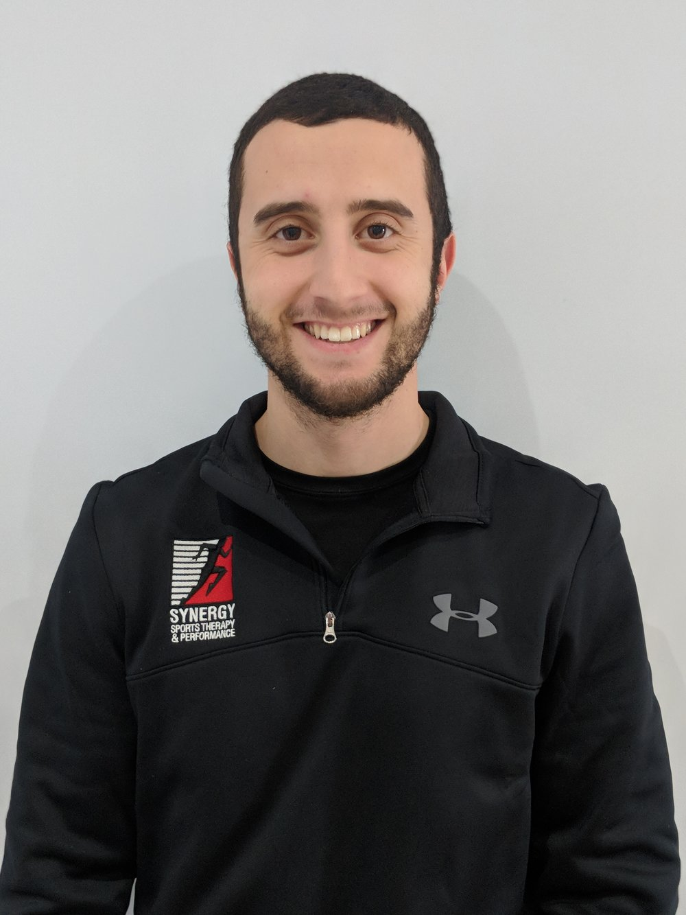 Philippe Hage-Moussa BSc, CAT(C)  Athletic Therapist NeuroKinetic Therapist  Phil graduated from Concordia University's athletic therapy program in 2016. He has always had a passion for sports and enjoys helping athletes of all level perform at their best.  Phil has had the chance of working with an abundance of athletes including the highly competitive Concordia Stingers female rugby team which ranked fourth at the 2015 CIS national championship. He also had the pleasure of working with the division one men's basketball team at Vanier college which ranked fourth at the 2014 CCAA national championship. He has worked with many other sports such as football, hockey, soccer, gymnastics, wrestling, and tennis.  In addition to his work as a therapist, Phil's passion for sports comes from his experience as a competitive soccer player. He has played at the AAA level for many years and still competes yearlong. He has also been coaching soccer at the high school level since 2012.  In the clinic, Phil takes a very functional approach when assessing and treating patients. Using his skills and knowledge in musculoskeletal rehabilitation, manual therapy, and strength and conditioning his ultimate goal is to help his patients return to their active lifestyle regardless of their fitness level.