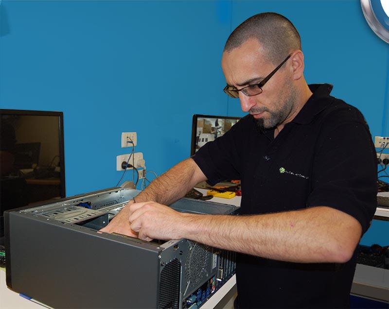 Q Professional repairing a workstation