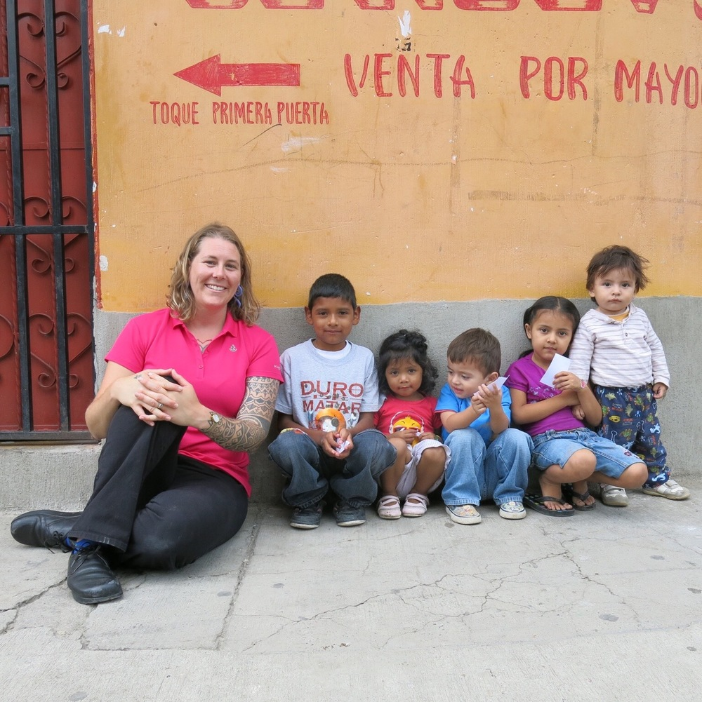 Dr. Jane Brewer with new friends and patients in Guatemala