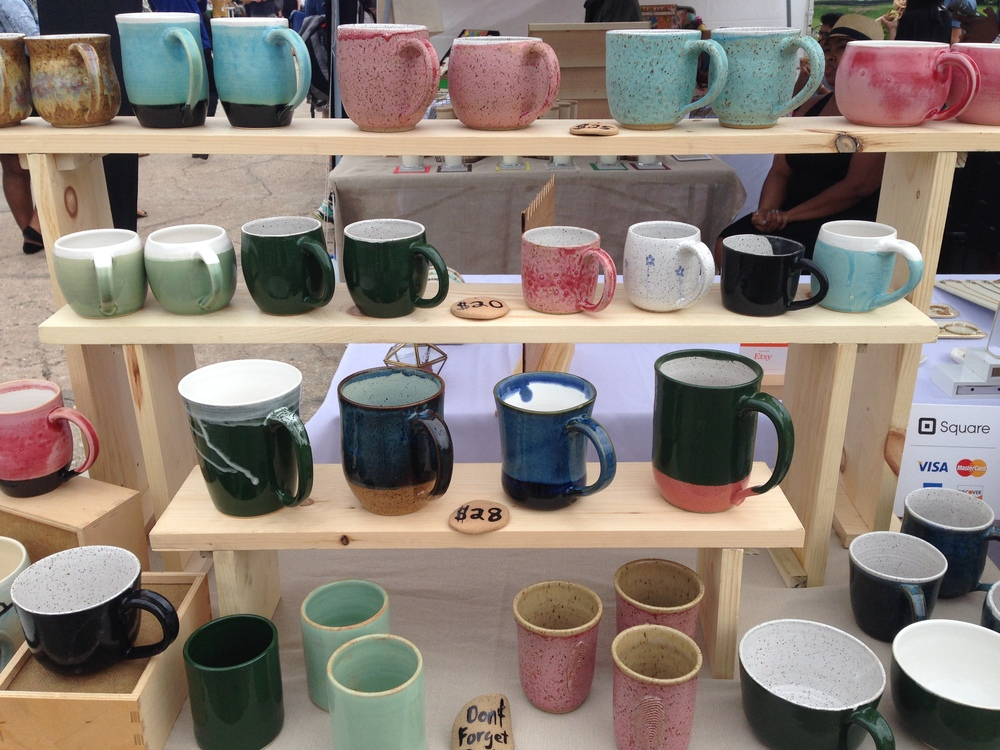 Mugs displayed on newly constructed shelves.  The rain didn't dampen our spirits!