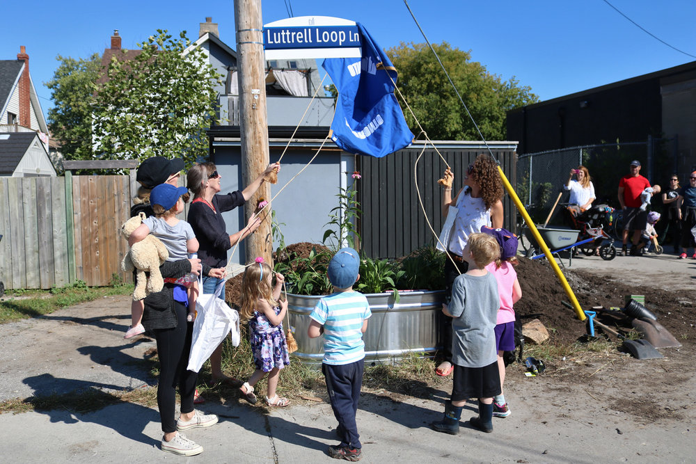 Image: Unveiling the new Luttrell Loop Lane sign CREDIT Katrina Afonso
