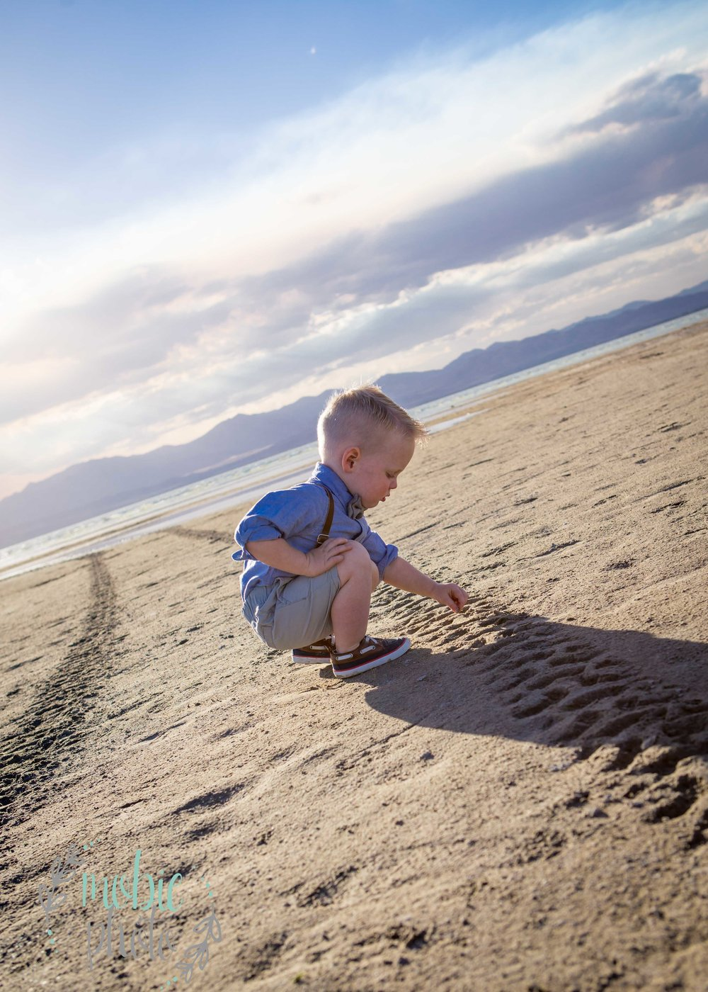 Little boy playing in beach sand