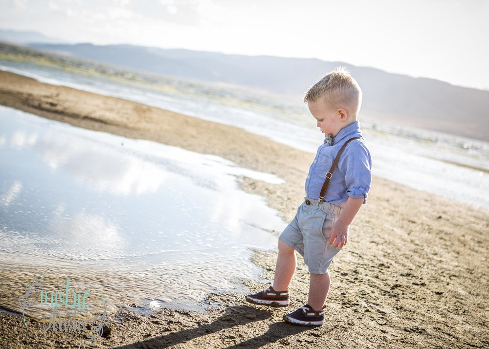 Little boy standing near the water