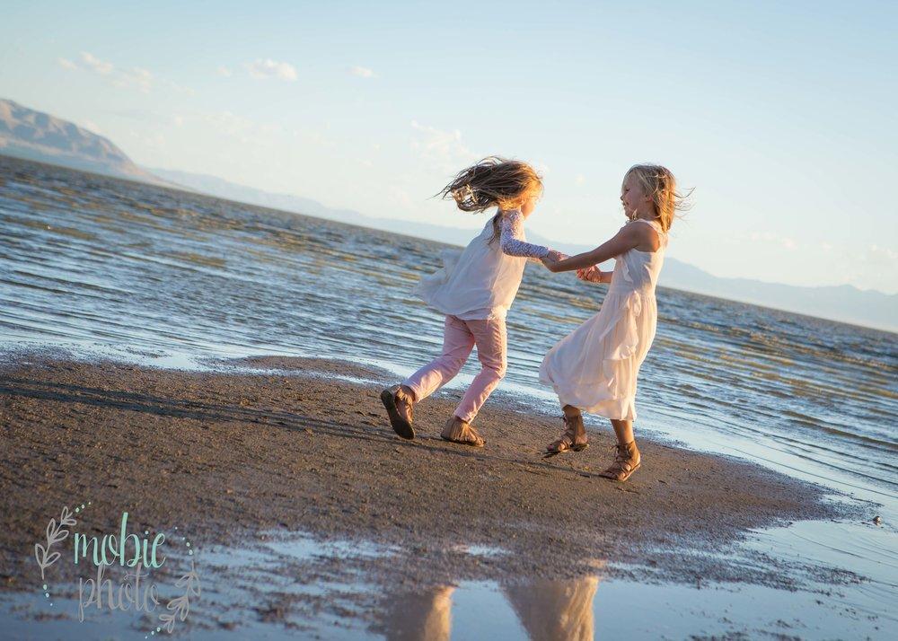 Sisters playing on the beach - Utah Lake