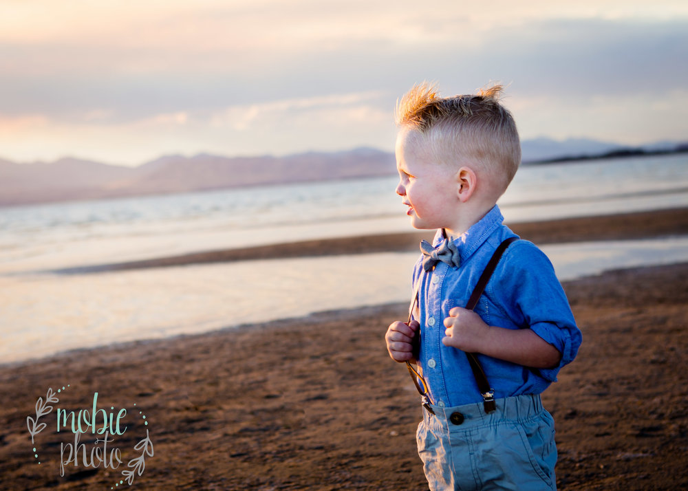 Little boy looking out to sea