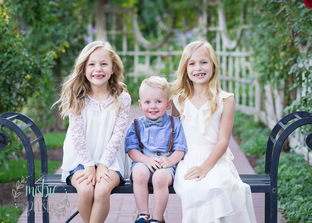 Siblings in a garden - Mobie Photo