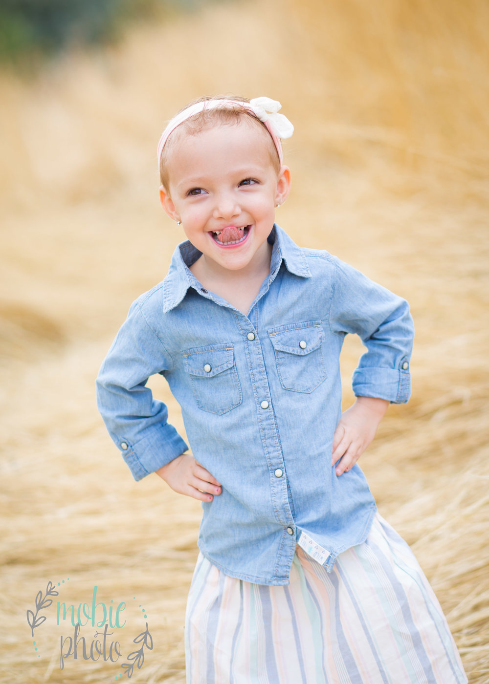 Little girl in denim shirt