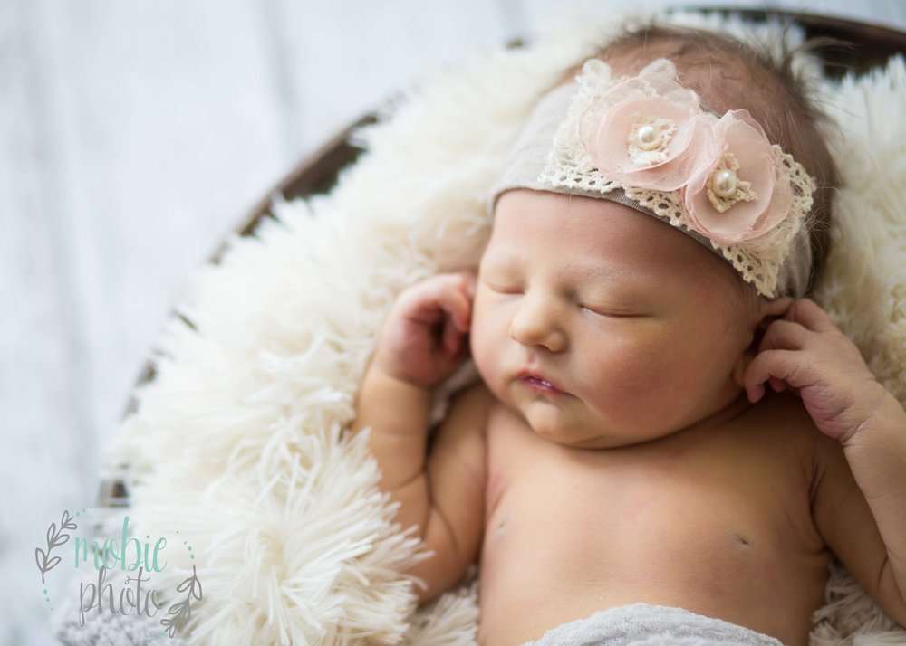 Newborn girl in metal basket