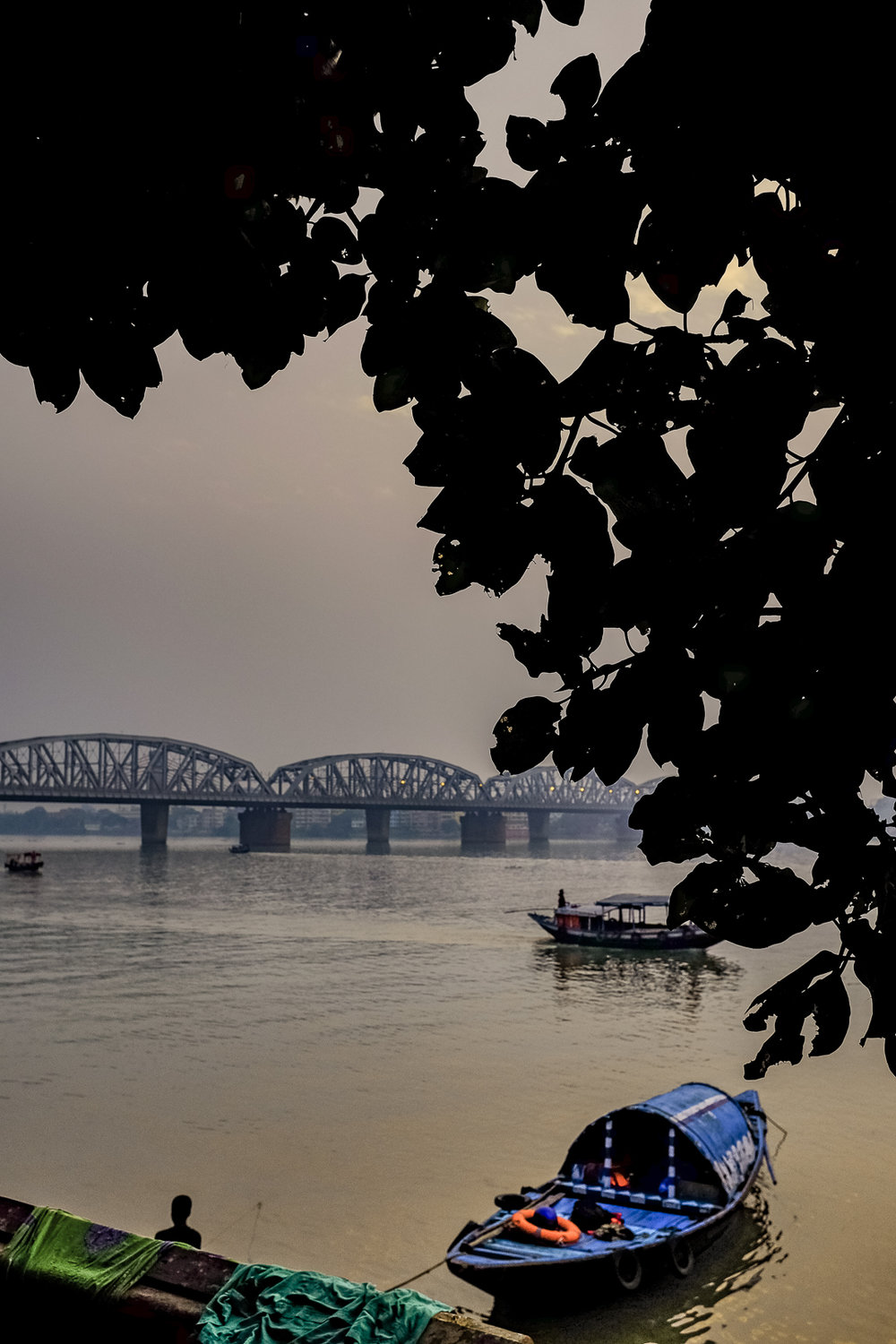 The thick, treacly waters of Hooghly, the last gasp of the Ganges before it runs into the Bay of Bengal.