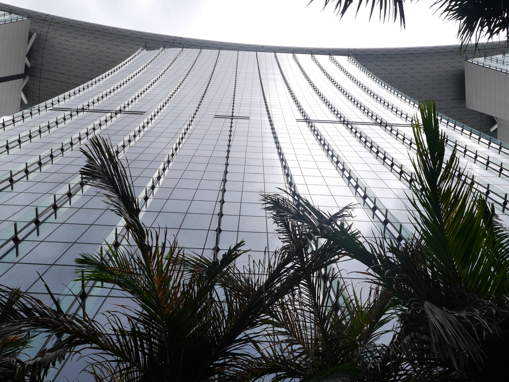 Looking up at one of the three towers of the Marina Bay Sands Hotel.