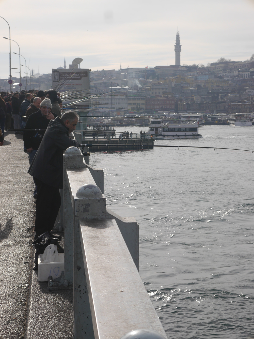 The  Galata Bridge , which we crossed on the way to the ferry terminal. Absolutely packed with fishermen.