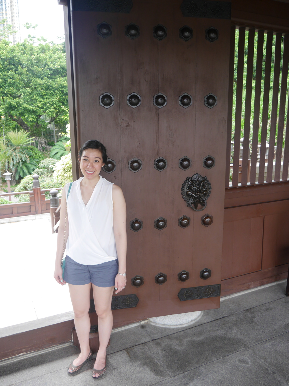 Grace posing next to one of the doors. I wish all my doors had massive, intricate dragon-head handles.