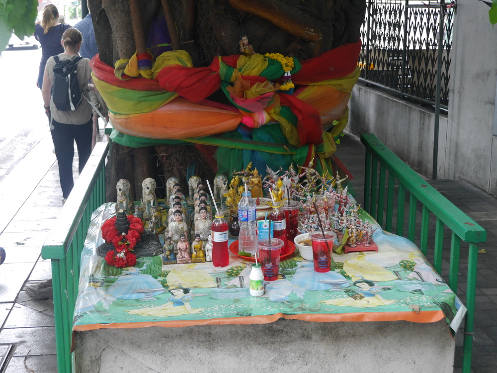 A shrine/area for offerings. Apparently red has significance, so people will leave random red drinks, in addition to other things.