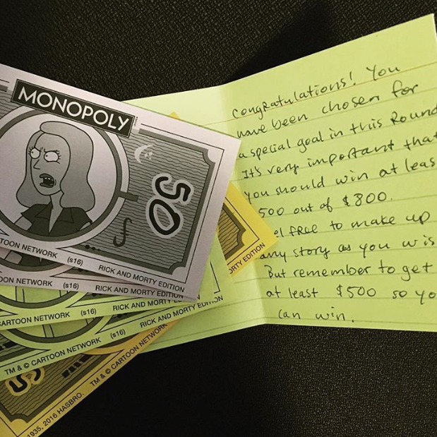 Photo of Monopoly money and secret instruction