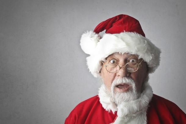 Elderly man dressed as santa
