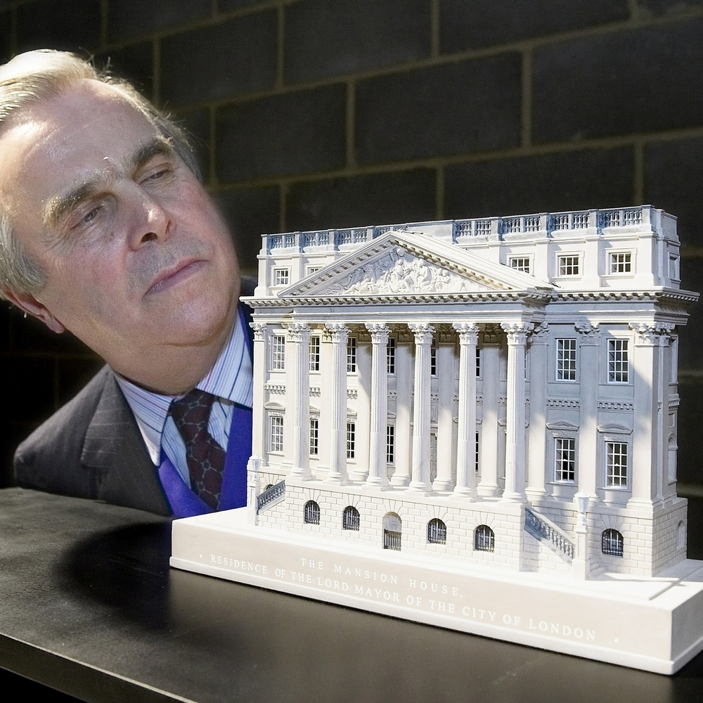 The Lord Mayor of London with his Mansion House model. This model has been used by the last six Lord Mayors as gifts when visiting countries around the world.   LORD MAYOR OF LONDON