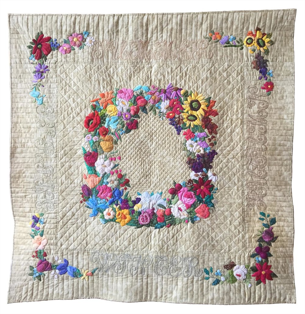 "Third place winner, ""Flowers Throughout the Seasons,"" a hand-stitched quilt by Judith Craddock."