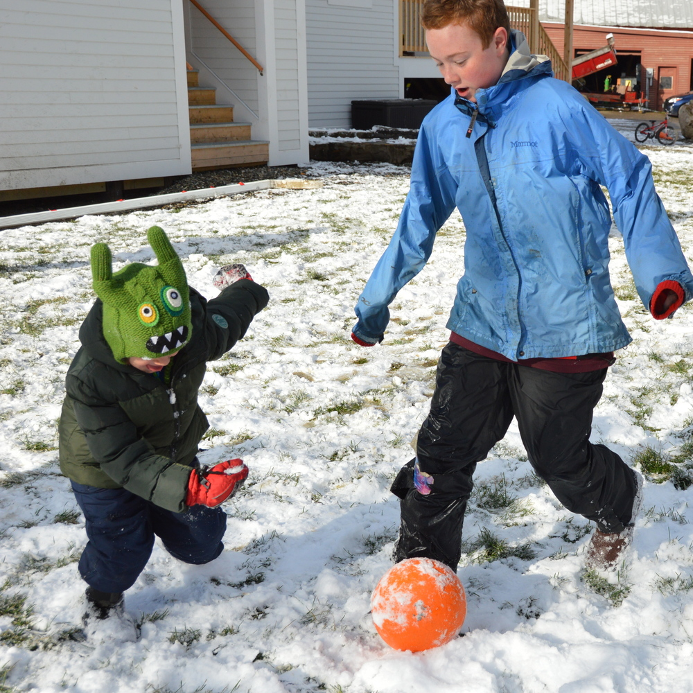 Todd Modifies his level of play to be inclusive of luca in snow soccer
