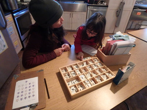 Victoria and Kathy use tiles and sand paper letters to make spelling a multi-sensory experience.