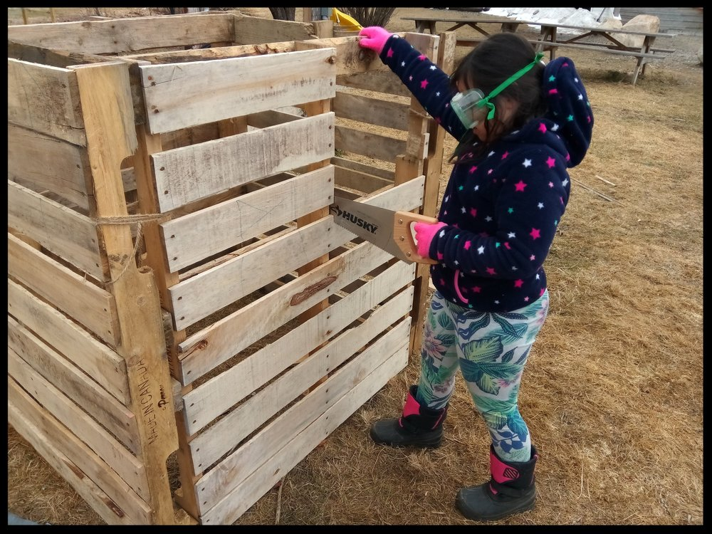 The Wild West - After reading about dugout shelters with a teacher, a group of students was curious...what other kinds of houses are there? How does the environment in which one lives determine house type? What kinds of homes were built in The Wild West? This group of students is using pallets to build their own house. They are installing a working door with hinges along with making a handmade rug and curtains for the interior. For some, this is the first time interest has been shown in using tools such as a saw and they are working hard!